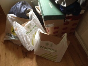 Three large bags of Sprout items sorted by destination, waiting to go to the Post Office