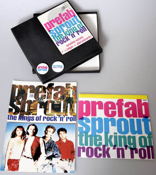 "We'll start with the ""Sproutbox"". Very easy to find indeed, but check all the contents are present: that includes 2 badges, 2 postcards, and a copy of ""King of Rock 'N' Roll"". The boxes often get squashed and scuffed, and occasionally you come across a shrinkwrapped version. But you don't have to pay more than a few quid, which is worth it just for the badges I think."